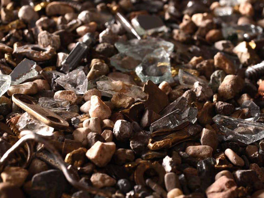 """Close-up of crushed pieces of wood mixed with other materials like glass, plastics etc.<span class=""""sr-only""""> (opened in a new window/tab)</span>"""