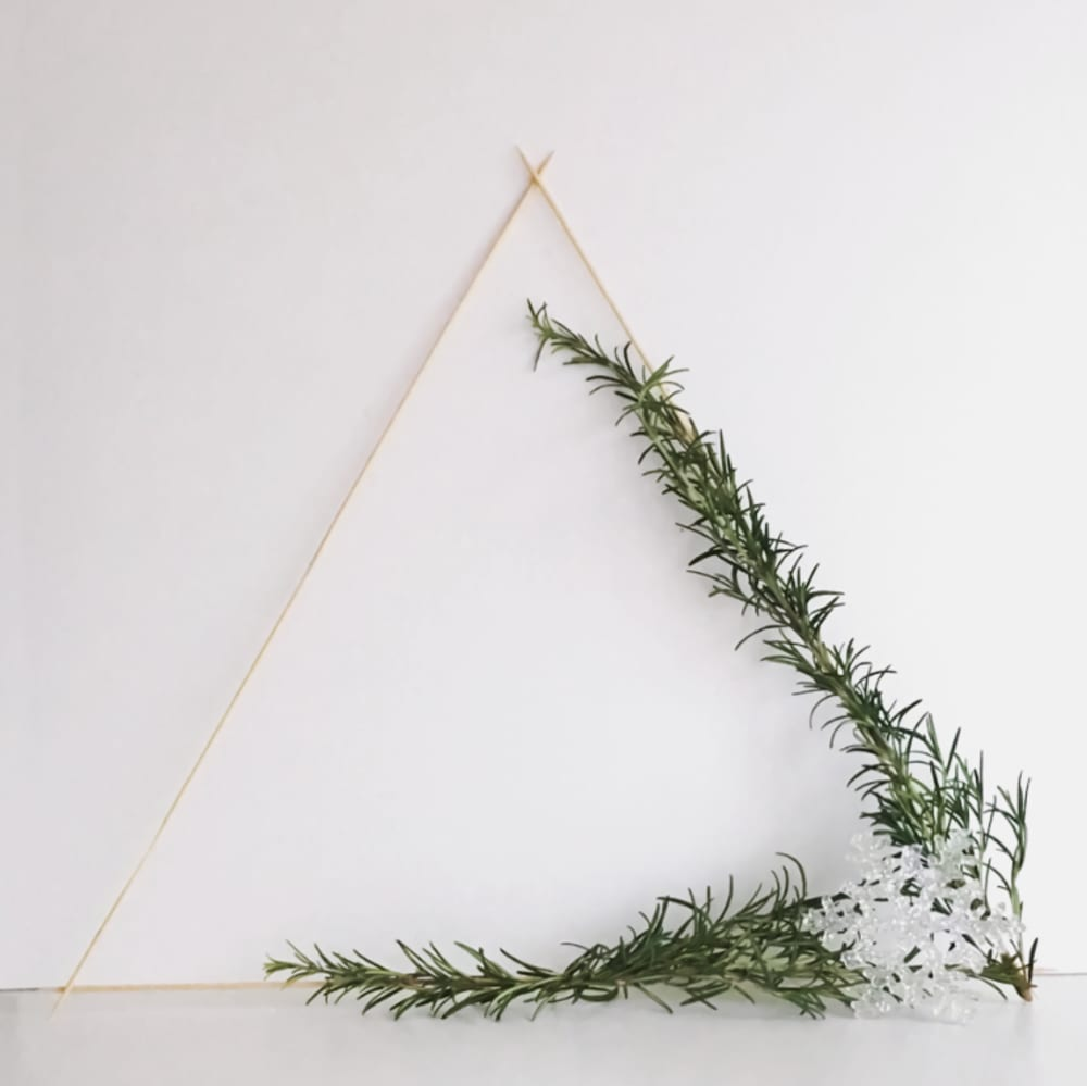 "Triangular wooden wreath decorated with rosemary twigs.<span class=""sr-only""> (opened in a new window/tab)</span>"