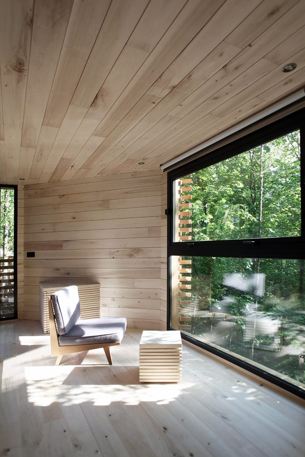 "View of the living area looking into the forest.<span class=""sr-only""> (opened in a new window/tab)</span>"