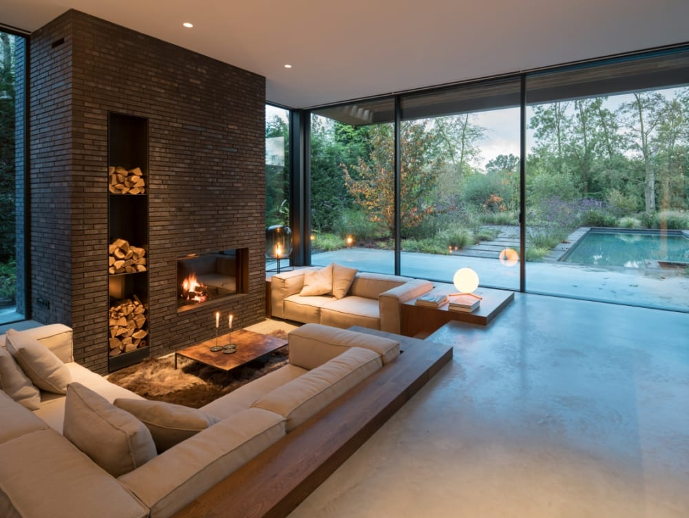 """Biophilic living room with big windows leaving the view to the outside totally open.<span class=""""sr-only""""> (opened in a new window/tab)</span>"""
