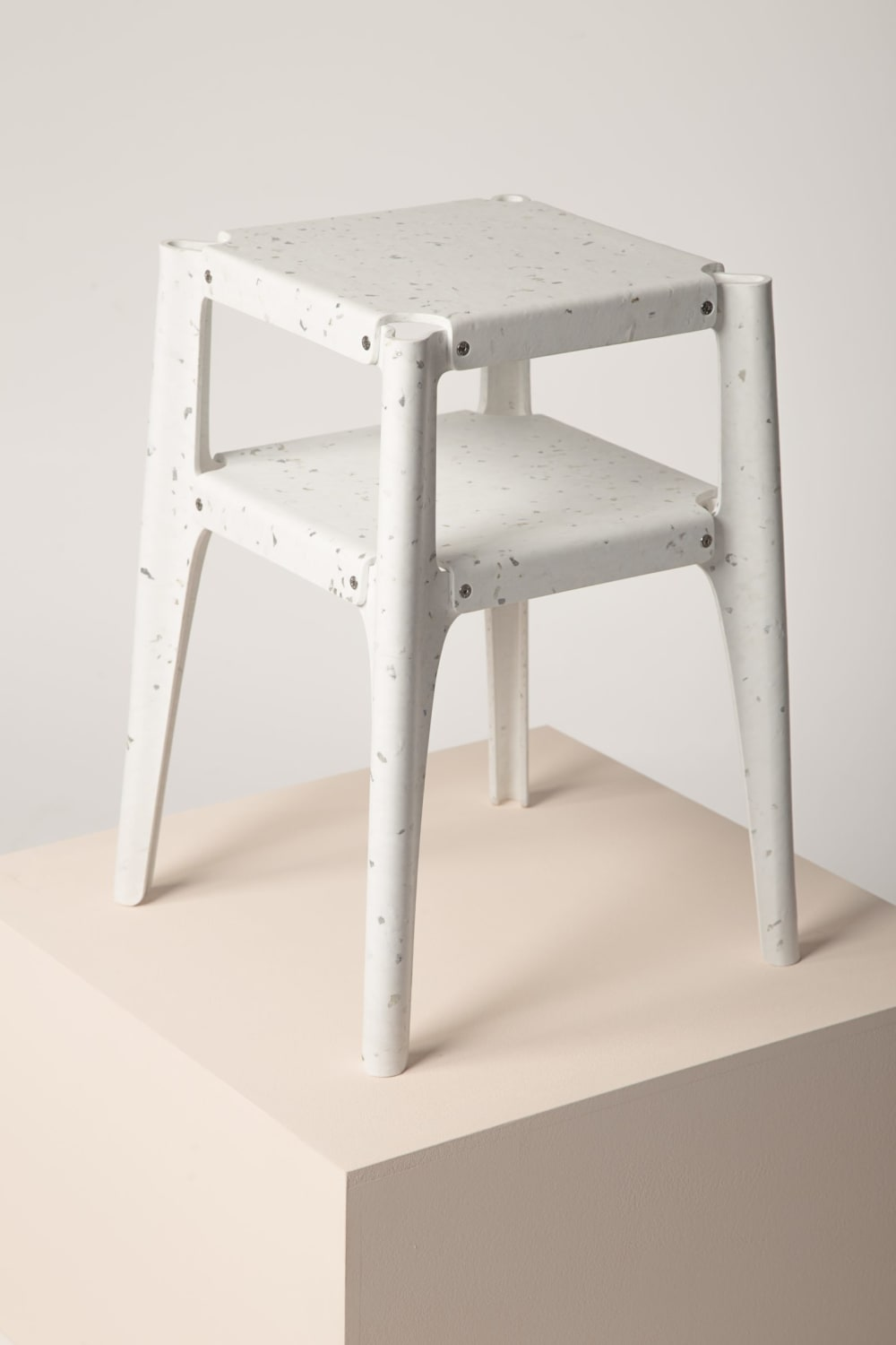 "Recycled plastic stool winning the Guiltess Plastic Prize: one of the plastic recycling initiatives presented at Milan Design Week.<span class=""sr-only""> (opened in a new window/tab)</span>"