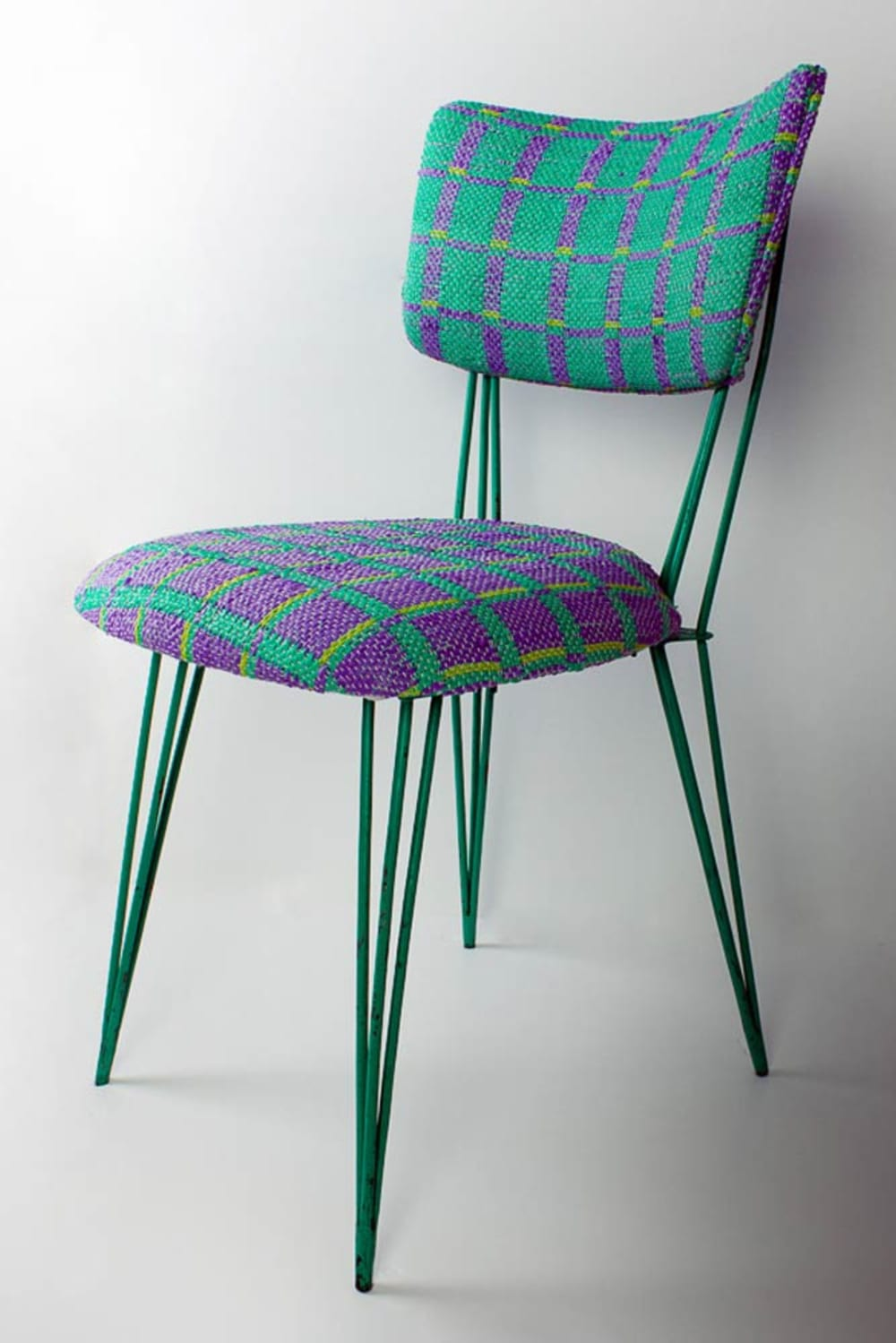 "Metal chair with seat upholstered with Plastex, a sustainable material made recycling plastic bags.<span class=""sr-only""> (opened in a new window/tab)</span>"