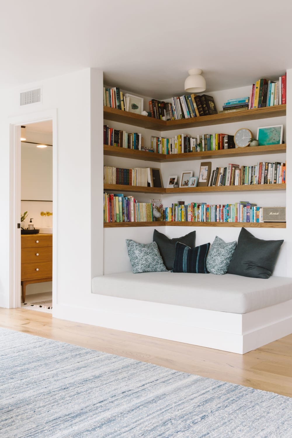 """Reading nook in a modern living room, great option to create a refuge area in a biophilic design.<span class=""""sr-only""""> (opened in a new window/tab)</span>"""