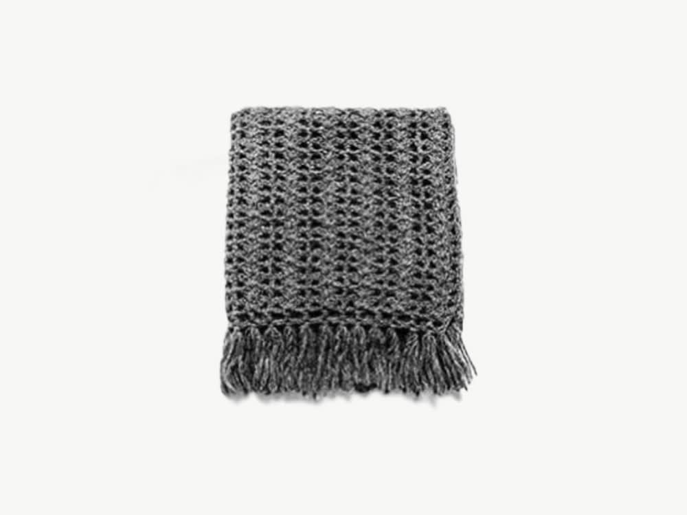"Dark grey crocheted blanket.<span class=""sr-only""> (opened in a new window/tab)</span>"