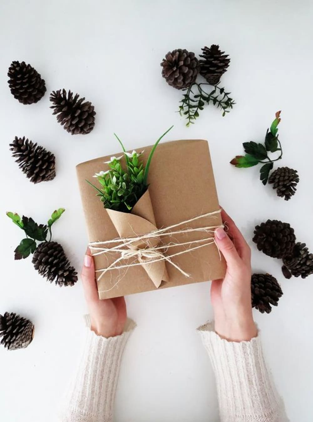 "Gift wrapped in brown paper and decorated with few twigs wrapped into brown paper like a flower bundle.<span class=""sr-only""> (opened in a new window/tab)</span>"
