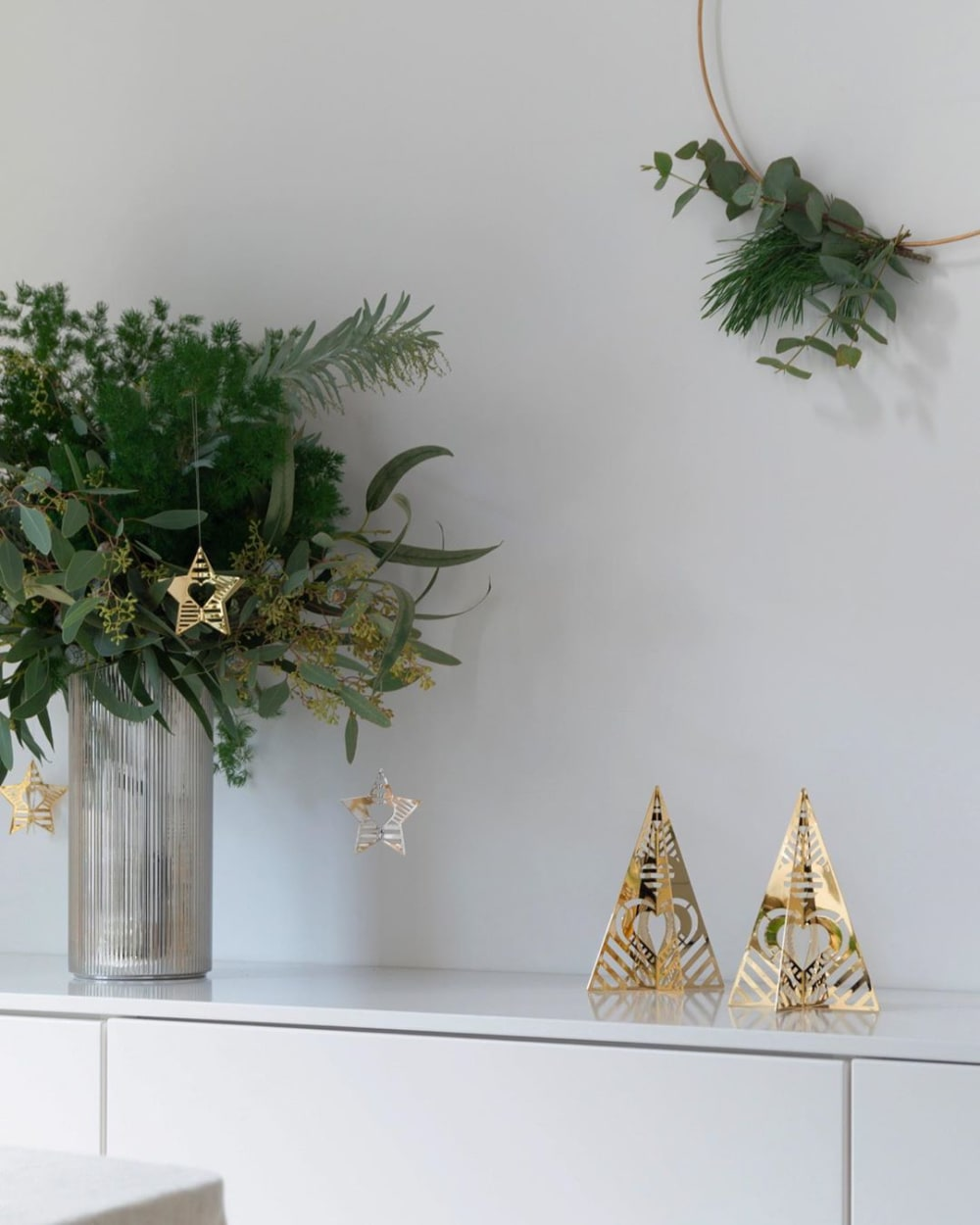 "Festive vignette created with real greenery and golden metal ornaments.<span class=""sr-only""> (opened in a new window/tab)</span>"