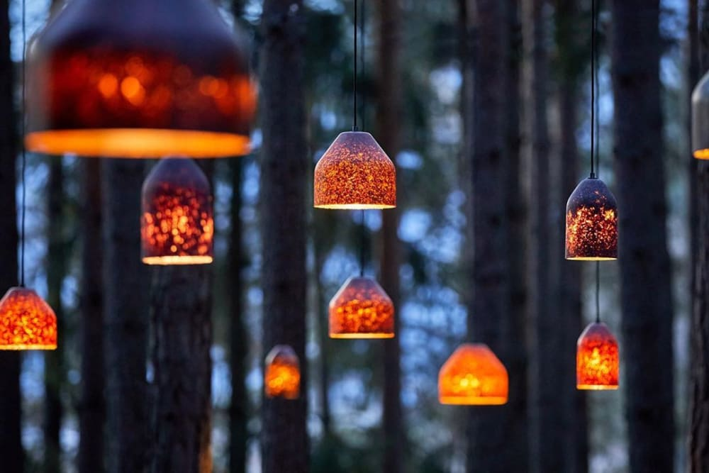 """Pendant lamp made of fallen leaves displayed in a forest.<span class=""""sr-only""""> (opened in a new window/tab)</span>"""