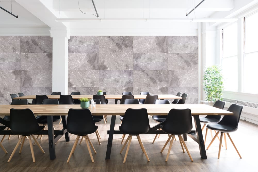 "Canteen design with the entire back wall covered in acoustic panels reproducing the pattern of stone slabs.<span class=""sr-only""> (opened in a new window/tab)</span>"