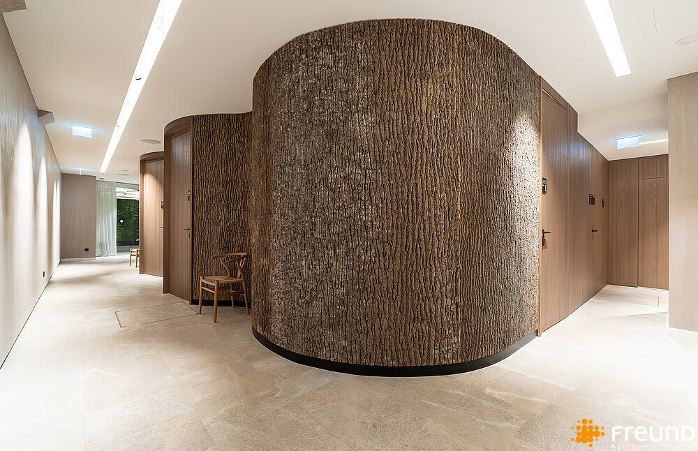 "Corridor with curved walls entirely covered with poplar bark panels.<span class=""sr-only""> (opened in a new window/tab)</span>"