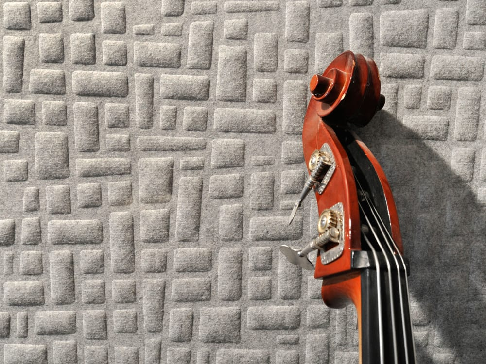 "Close-up of a wool acoustic panel with a geometric pattern.<span class=""sr-only""> (opened in a new window/tab)</span>"