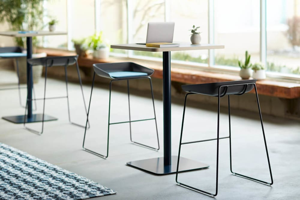 "Tall tables with Cradle to Cradle Certified™ stools.<span class=""sr-only""> (opened in a new window/tab)</span>"