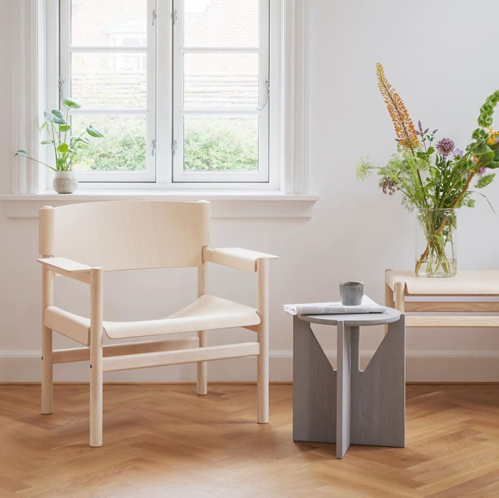 "FSC® certfied chair styled with side table and flowers.<span class=""sr-only""> (opened in a new window/tab)</span>"