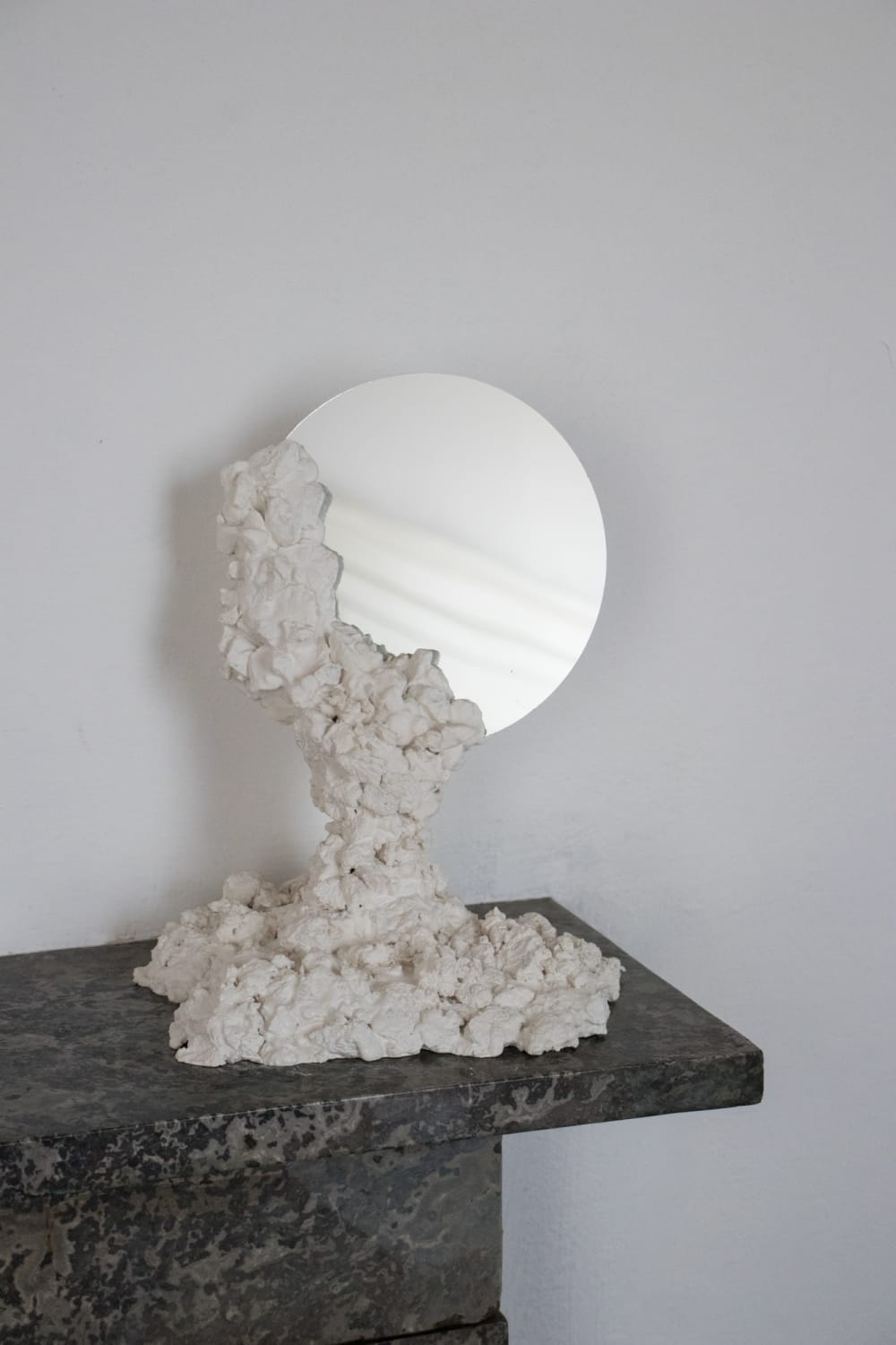 """Round mirror kept in place with a recycled stone base.<span class=""""sr-only""""> (opened in a new window/tab)</span>"""
