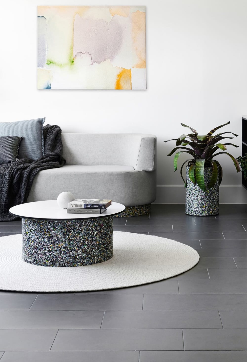 "Contemporary living room with sofa and coffee table with legs made of recycled plastic terrazzo.<span class=""sr-only""> (opened in a new window/tab)</span>"