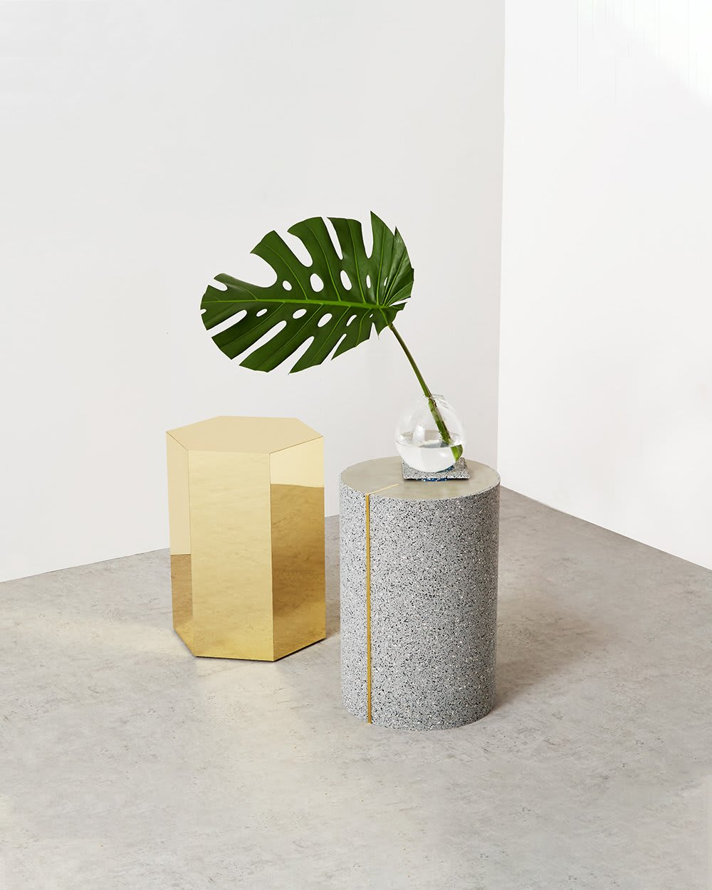 "Minimal shot displaying a light grey side table made of recycled rubber.<span class=""sr-only""> (opened in a new window/tab)</span>"