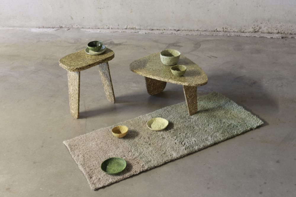 """Collection of low tables, bowls and rug made with stinging nettle.<span class=""""sr-only""""> (opened in a new window/tab)</span>"""