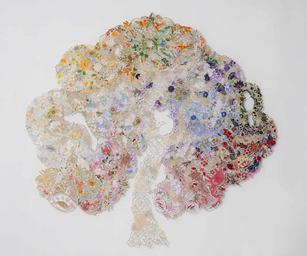 "Textile art tree made up of reused pieces of needlework, pins and tulle.<span class=""sr-only""> (opened in a new window/tab)</span>"
