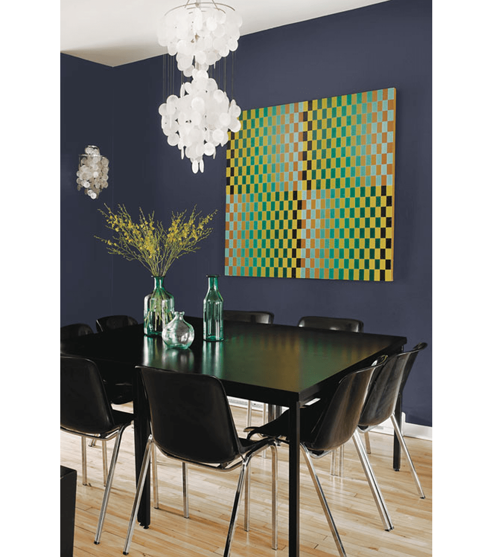 "Dining area with black furniture. Back wall painted in Black Flame (2018 colour of the year by PPG paints). The big artwork in the tones of green, yellow and black matches with the vases on the table.<span class=""sr-only""> (opened in a new window/tab)</span>"