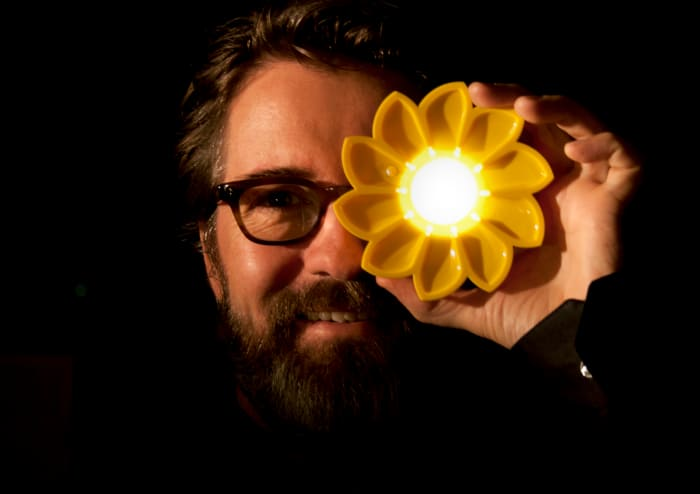 "The founder of Little Sun showing their sustainable flashlight.<span class=""sr-only""> (opened in a new window/tab)</span>"