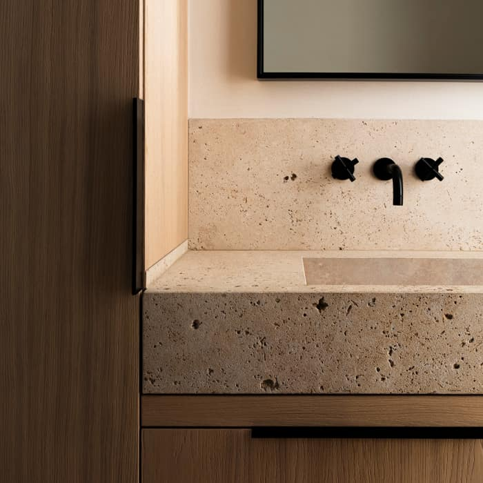"Stone bathroom sink on a wood vanity, great example of biophilic design.<span class=""sr-only""> (opened in a new window/tab)</span>"