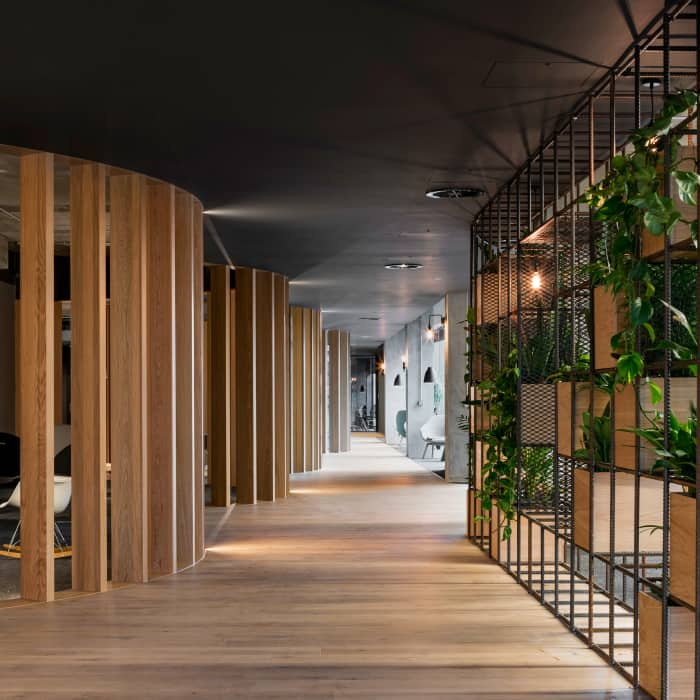 "Slack European Office, which applies biophilic design using wood partitions and plants.<span class=""sr-only""> (opened in a new window/tab)</span>"