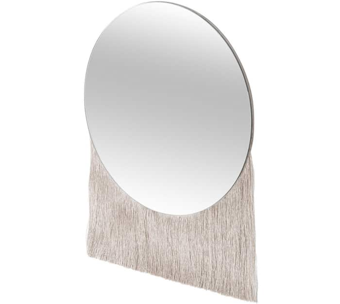 "Round mirror with fringe falling from the bottom, by Oliver Bonas.<span class=""sr-only""> (opened in a new window/tab)</span>"
