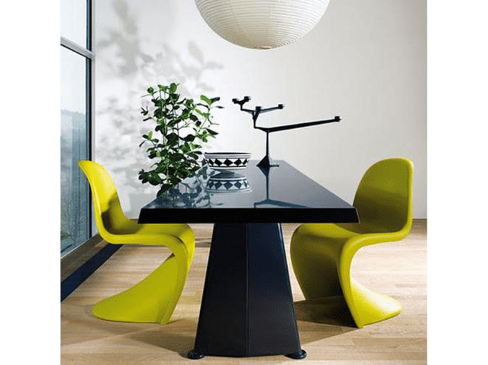 Chartreuse Panton chairs around a modern black table. Chartreuse Panton chairs around a modern black table.
