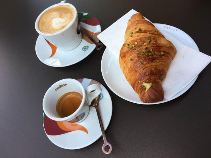 Overtop view of a typical Italian breakfast: coffee, cappuccino and croissant.