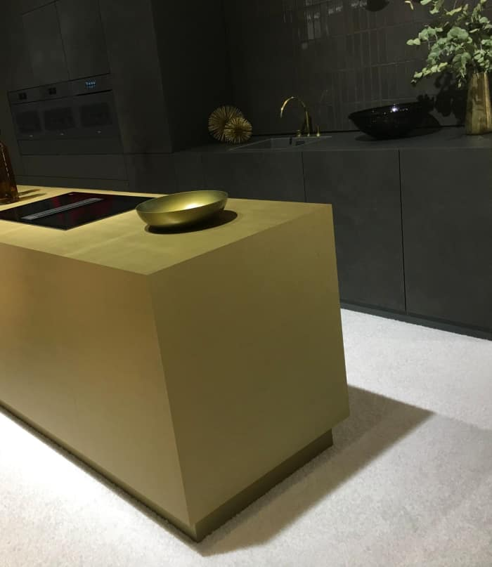 Gold kitchen island and gold accessories.