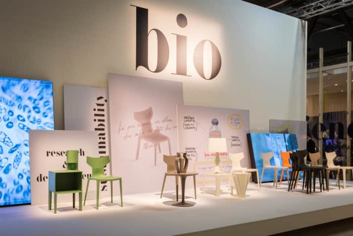 Exposition of Kartell at Milan Design Week, showing the new Bio chair and other iconic pieces, all produced with the new biopolymer.
