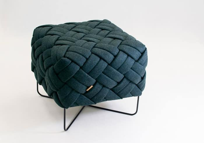 Stool with wool knotted seat and thin metal legs, by Kumeko Design.