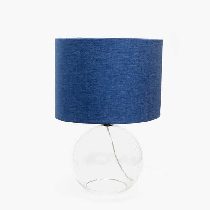 """Table lamp with denim shade and see-through glass lamp, by Zara Home.<span class=""""sr-only""""> (opened in a new window/tab)</span>"""