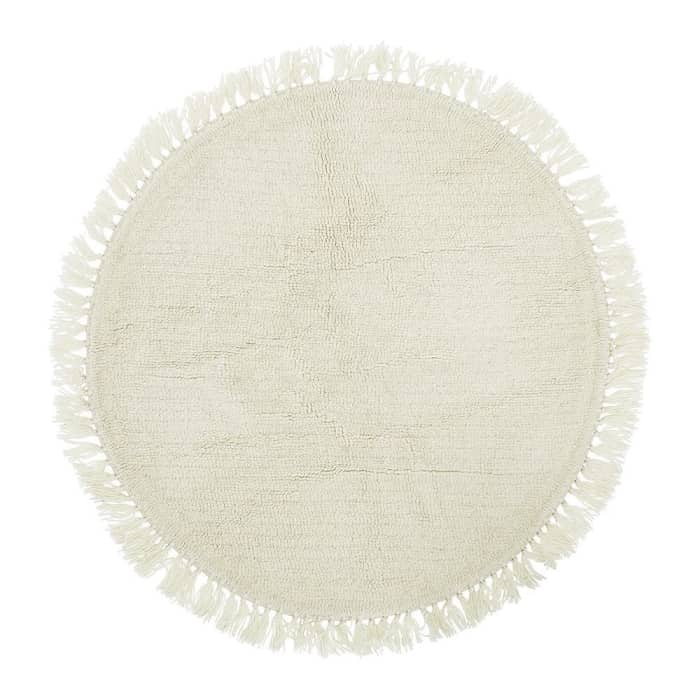 Round rug with tassels on the whole border, by Bloomingville.