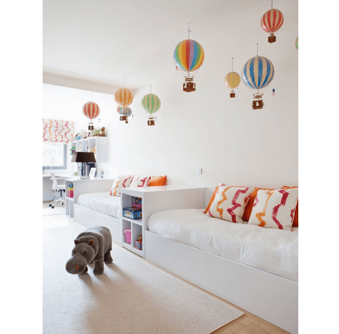 Colourful hot-air balloons drop down from a pure white ceiling. Colourful hot-air balloons dropping down from a pure white ceiling.