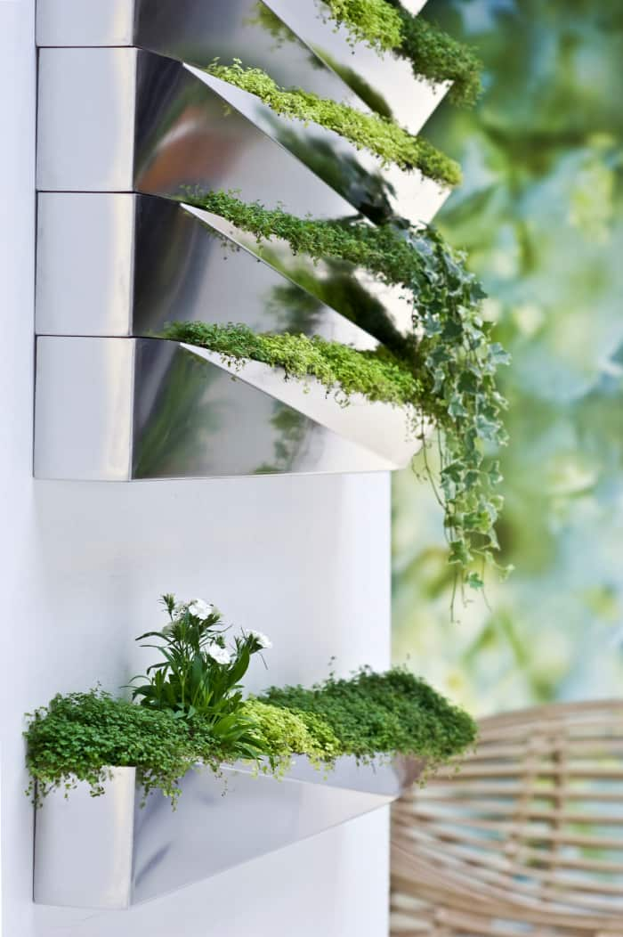 """Close-up of the planter highlighting its reflective surface.<span class=""""sr-only""""> (opened in a new window/tab)</span>"""
