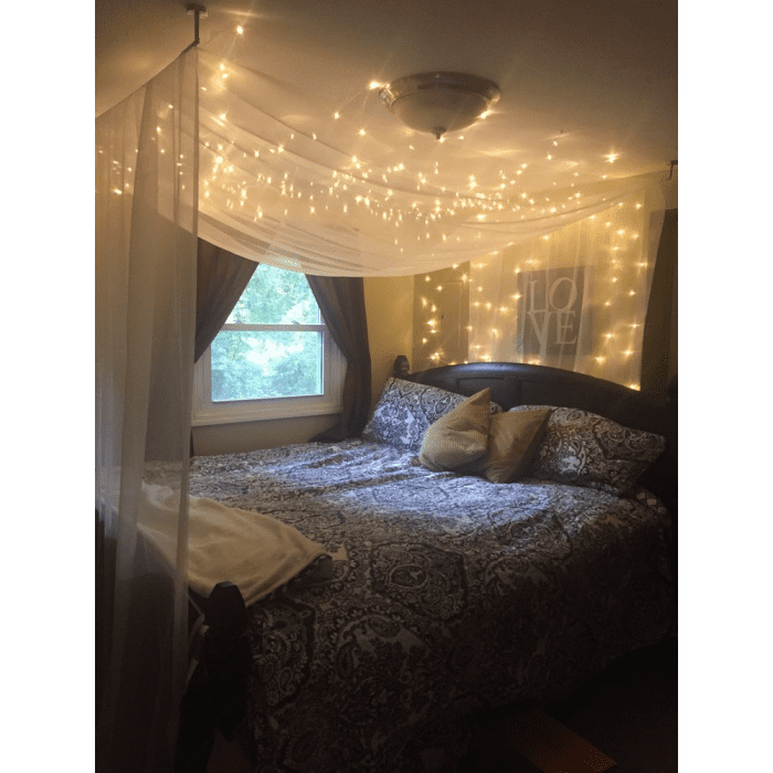 Canopy bed with starry lights running all across.