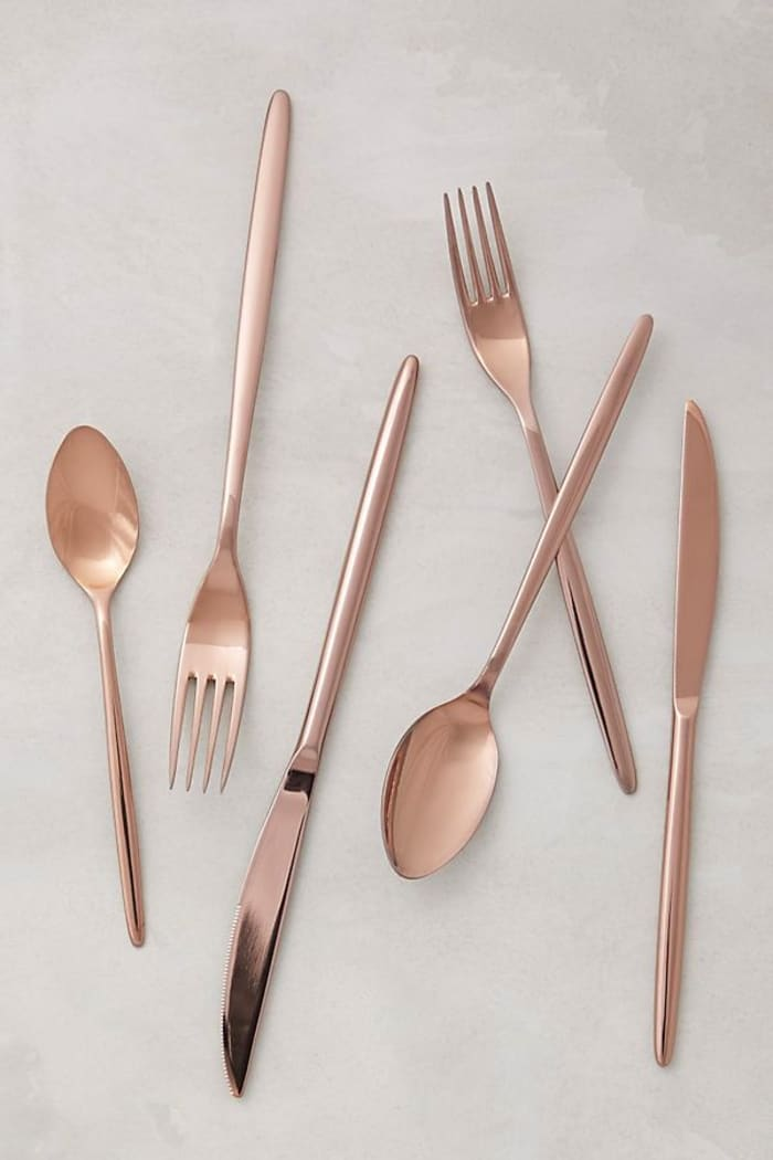 Minimalist cutlery set in rose-pink; Doma by Anthropologie.