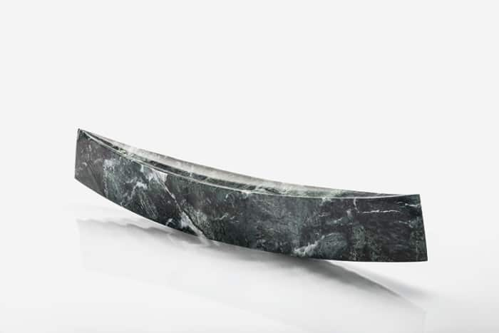 The marble version of Gondola, a minimalist sculpture-container by Danese Milano.