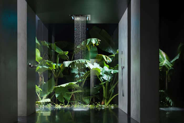 Waterfall shower with full height plants behind.