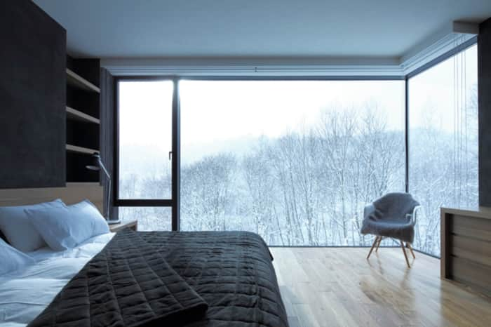 Bedroom with winter outside view, great example of biophilic design.