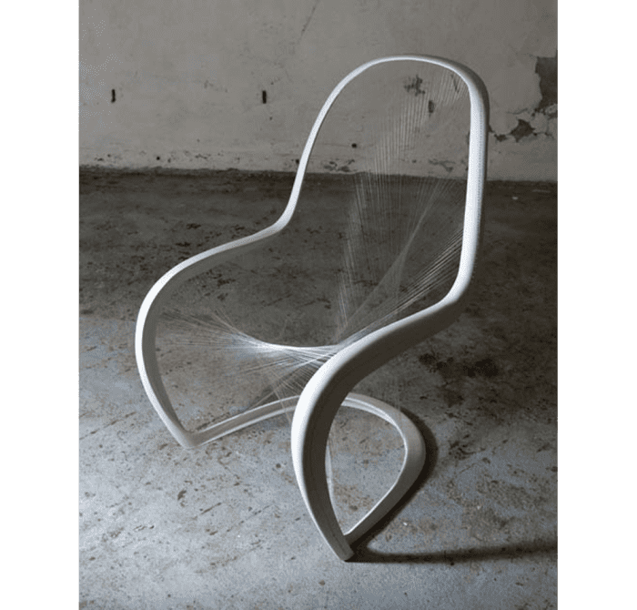 Mesh Panton chair. Solid white outline connected by thin clear mesh, making the seat almost invisible.