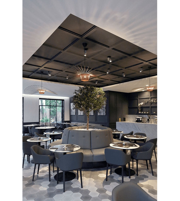 Restaurant interior with modern-looking black coffered ceiling.