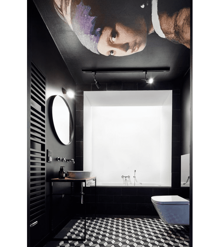"Black bathroom with a reproduction of Jan Vermeer's painting ""Girl with a Pearl Earring"" on the ceiling."