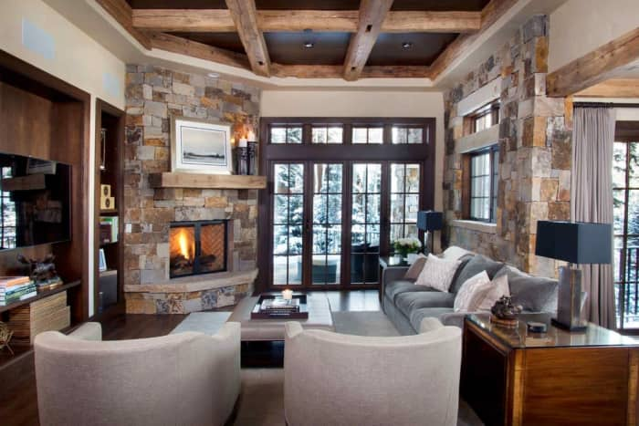 Rustic living room with wooden coffered ceiling.