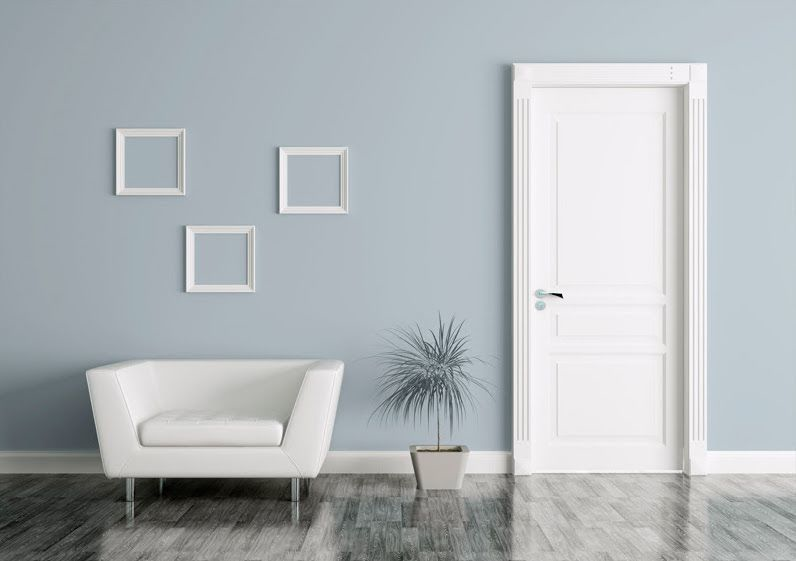 The white of an armchair, a door and three wall frames, creates a peaceful contrast with the background wall, painted in Atmospheric Pressure (2018 colour of the year by Diamond Vogel).