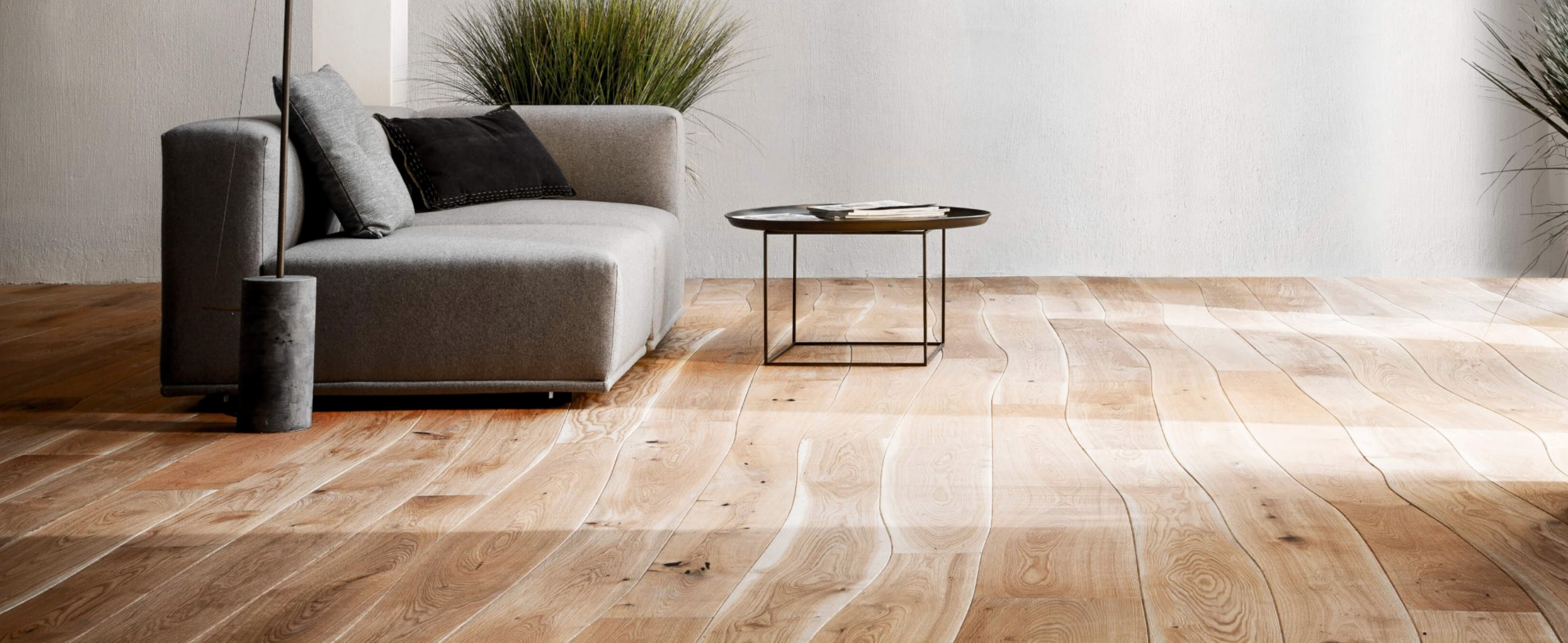 Curved wooden flooring, a great option for a biophilic design.