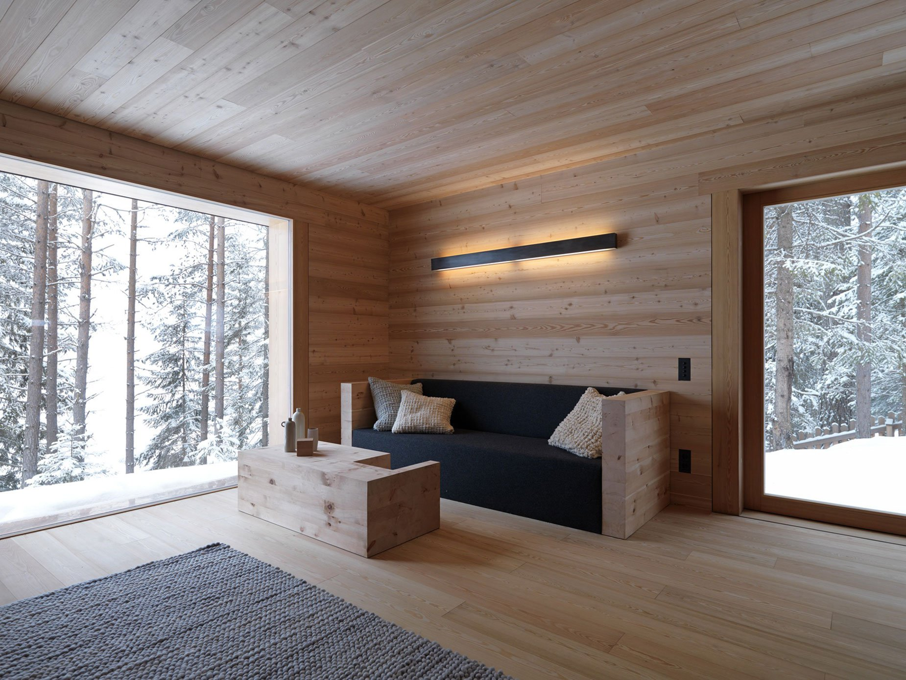 Wood panelling on floor and wall, great inspiration for a biophilic design.