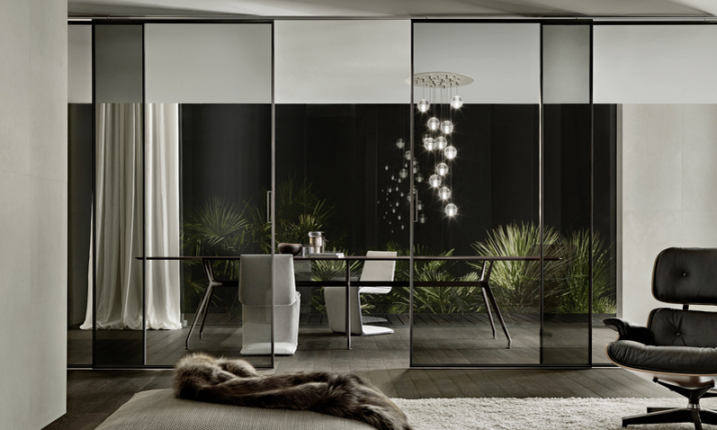 Glass partition bewteen living and dining room, great example of biophilic design.