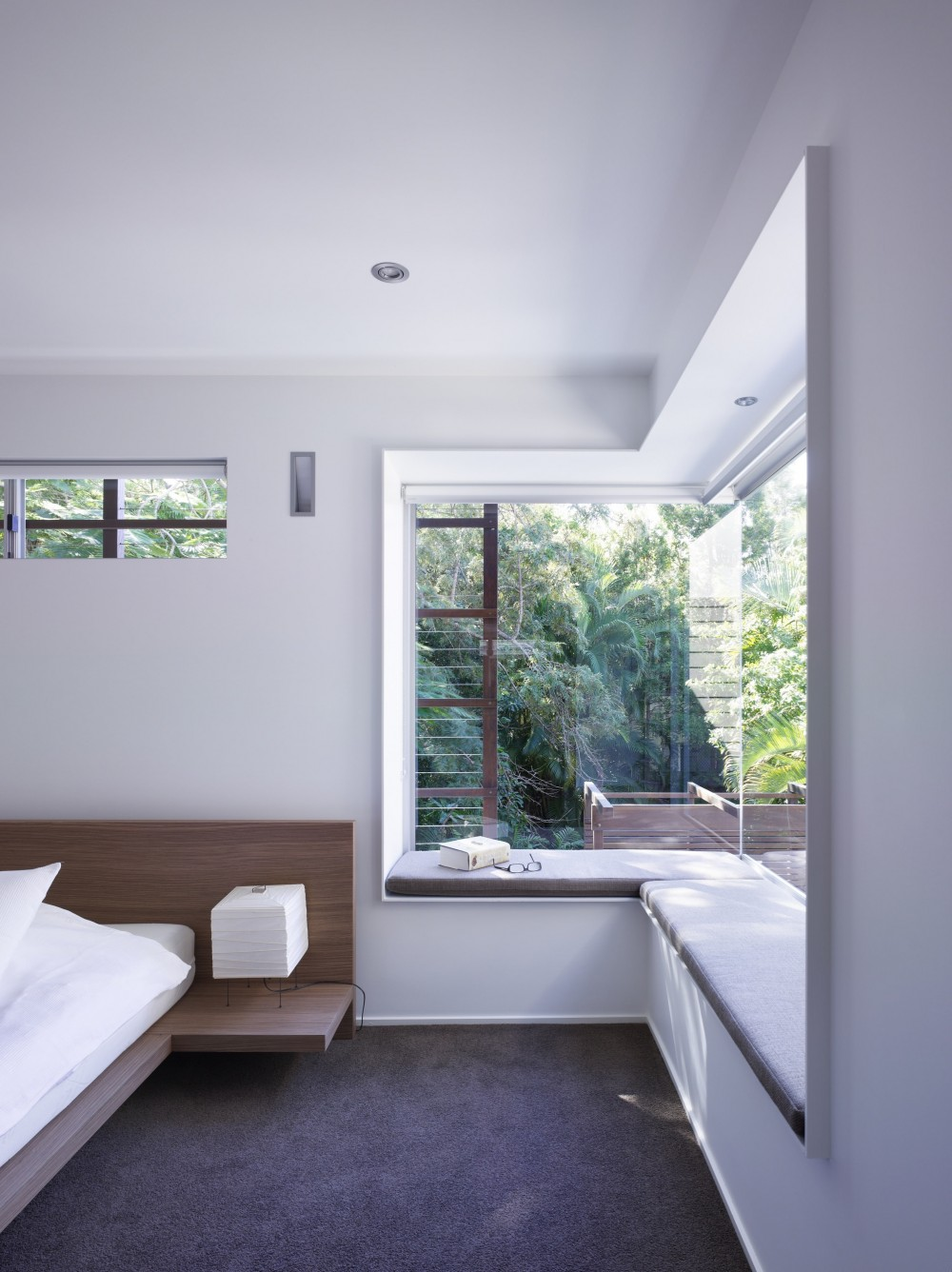 Window seat in a modern bedroom, great option to create a refuge area in a biophilic design.