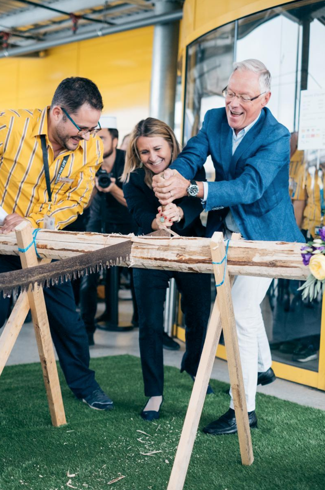 Cutting a branch of wood at IKEA's Aubonne inauguration in September 2017.